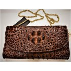 Women's handbag is a clutch of genuine crocodile leather.